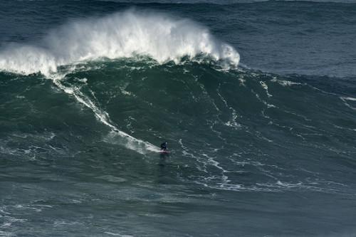 Maya Gabeira surfs a big wave at Praia do Norte, Nazaré, Portugal