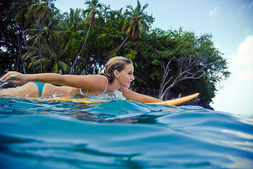 girl-on-shortboard-paddling